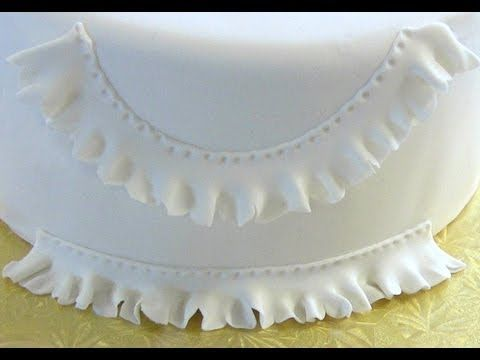 http://www.CakeSuppliesPlus.com for cake photos and supplies in video.   Like us on facebook at http://www.facebook.com/CakeSuppliesPlus  Cake Decorating: How to Make Fondant Ruffles or Fondant Frills or Gum Paste (Gumpaste) Ruffles or Frills