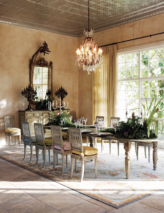 Large is the way I see this dining room. Ceiling, windows, mirror! It is a wonderful space