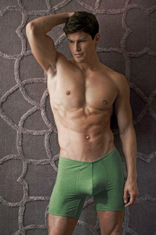 a17ecedd55cc Buffed hunky male model wearing medium green boxer brief   The Color ...