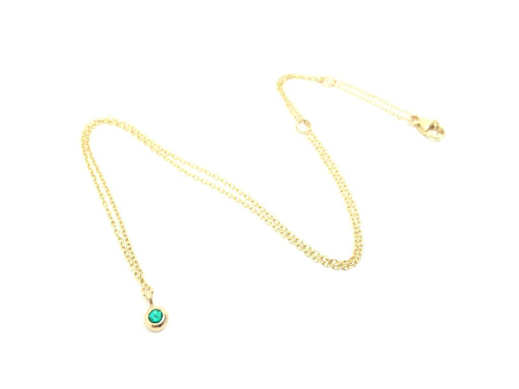 Genuine emerald stone set in solid k gold on a k gold chain that