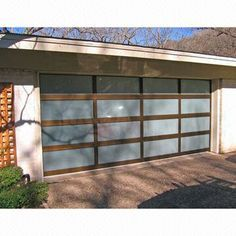 Our Hurricane Resistant Impact Garage Doors With Windows Glass Garage Door Garage Doors Outdoor House Colors