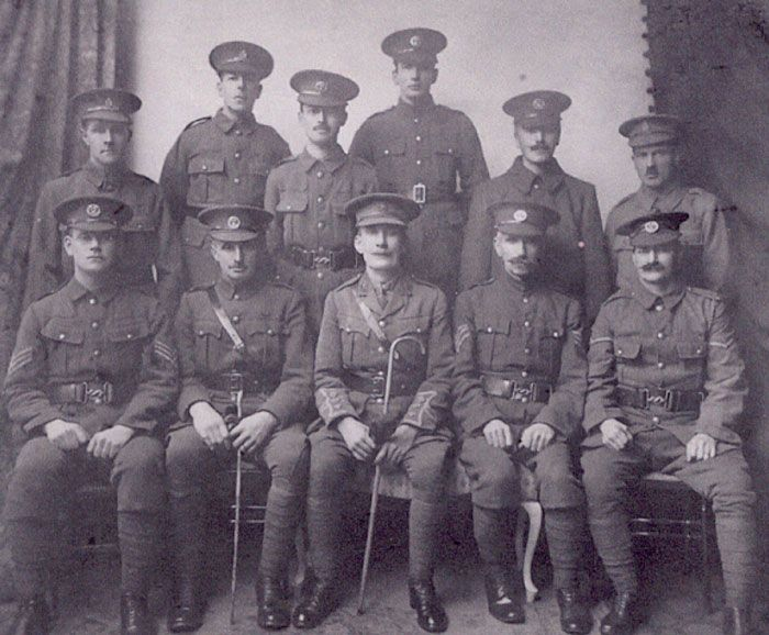 Men of the 3rd Hampshire Volunteer Battalion at Bedhampton, posing for the camera in what looks like a local community hall.  Not all volunteer recruits were sent on active service; some were kept at home as the forerunner of Dads Army and undertook local guard duties. HMCMS:DPAAIT24
