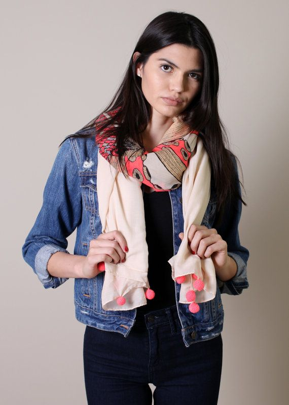 This Octopus print scarf in fluorescent camelia rose color on neutral cream base, and cute pink pom pom detail. Its unique and flattering, compliments galore! Perfect for everyday use, great for travel, light and easy to carry, and versatile for both work or play. Drape it around your neck, use it as a shoulder wrap / evening shawl, beach wrap, etc. Its versatile and chic. Size: 42X 70. Super Soft Polycotton. Oversize. With decorative peach pom-pom trim along the edges.  Charming and…