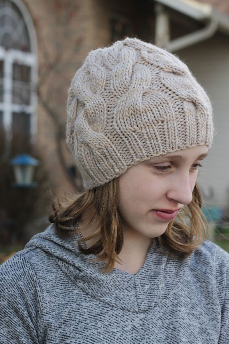 f2faa455747 the skalbagge cabled hat is a free knitting pattern for a beginner-friendly  hat with alternating cables that decrease into the crown.