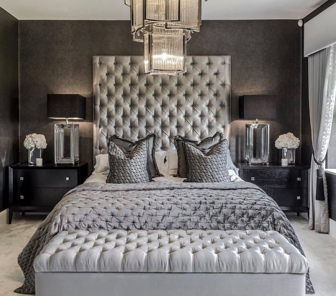 Gorgeous Monochromatic grey luxury bedroom with extra tall headboard
