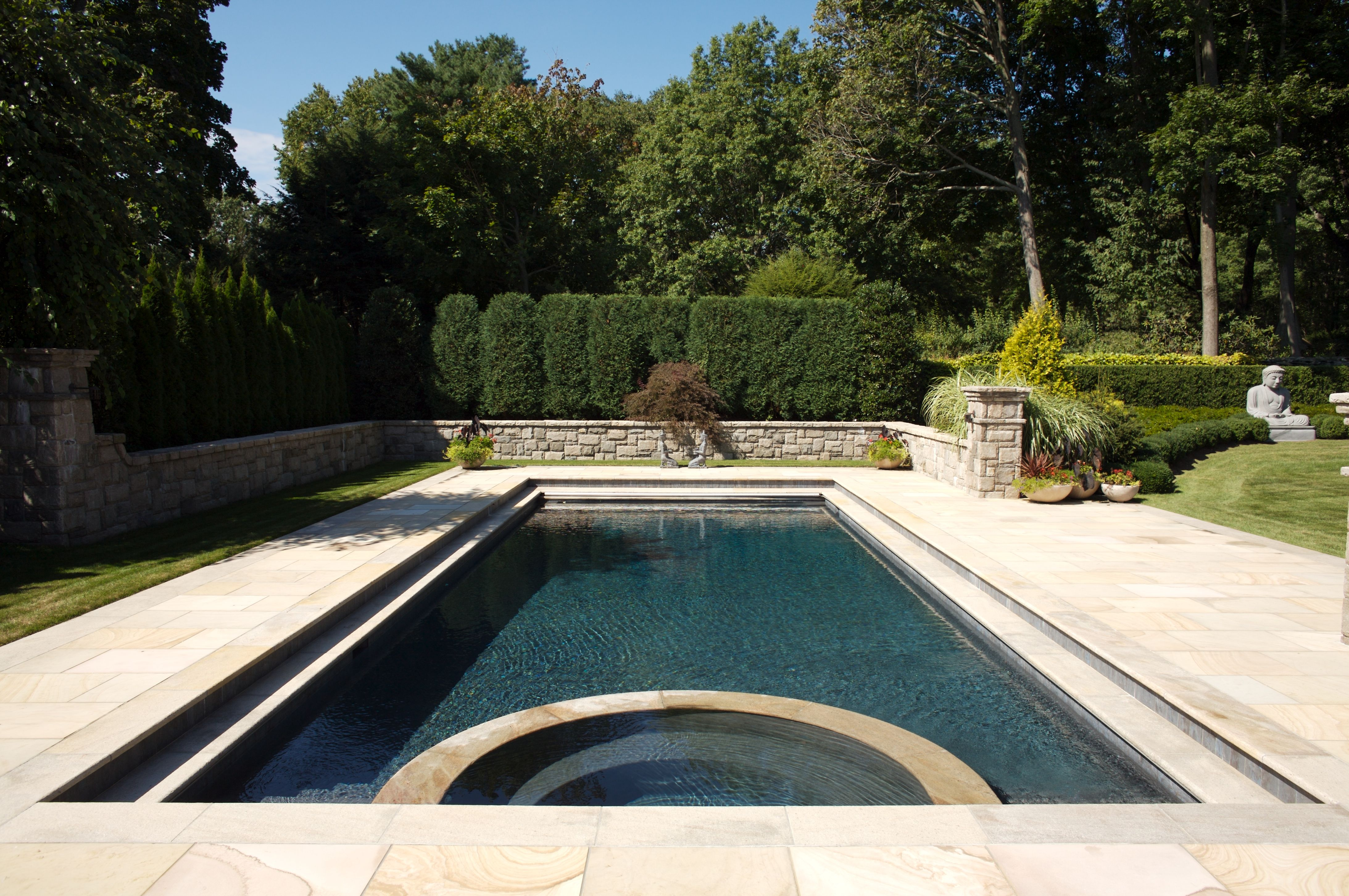 A Low Sitting Wall Wraps Around The Rectangular Pool