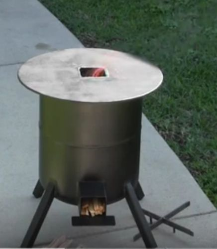 Propane Tank To Rocket Stove Conversion Diy Project Homesteading The Homestead Survival Com Please Share This Pin Rocket Stoves Propane Tank Barrel Stove