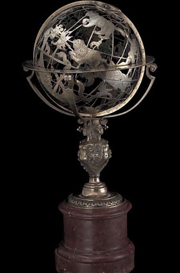 The globe is made of gilded brass, in two  halves joined at the equator; its diameter is  13 inches (33 cm), and the diameter of the  horizon ring 16 inches (41 cm). The overall  height of the globe on its stand is 34 inches  (86 cm).The base is a red marble cylinder with  profiled base ring, with a cast brass ornamental  stem. Ca. 1598