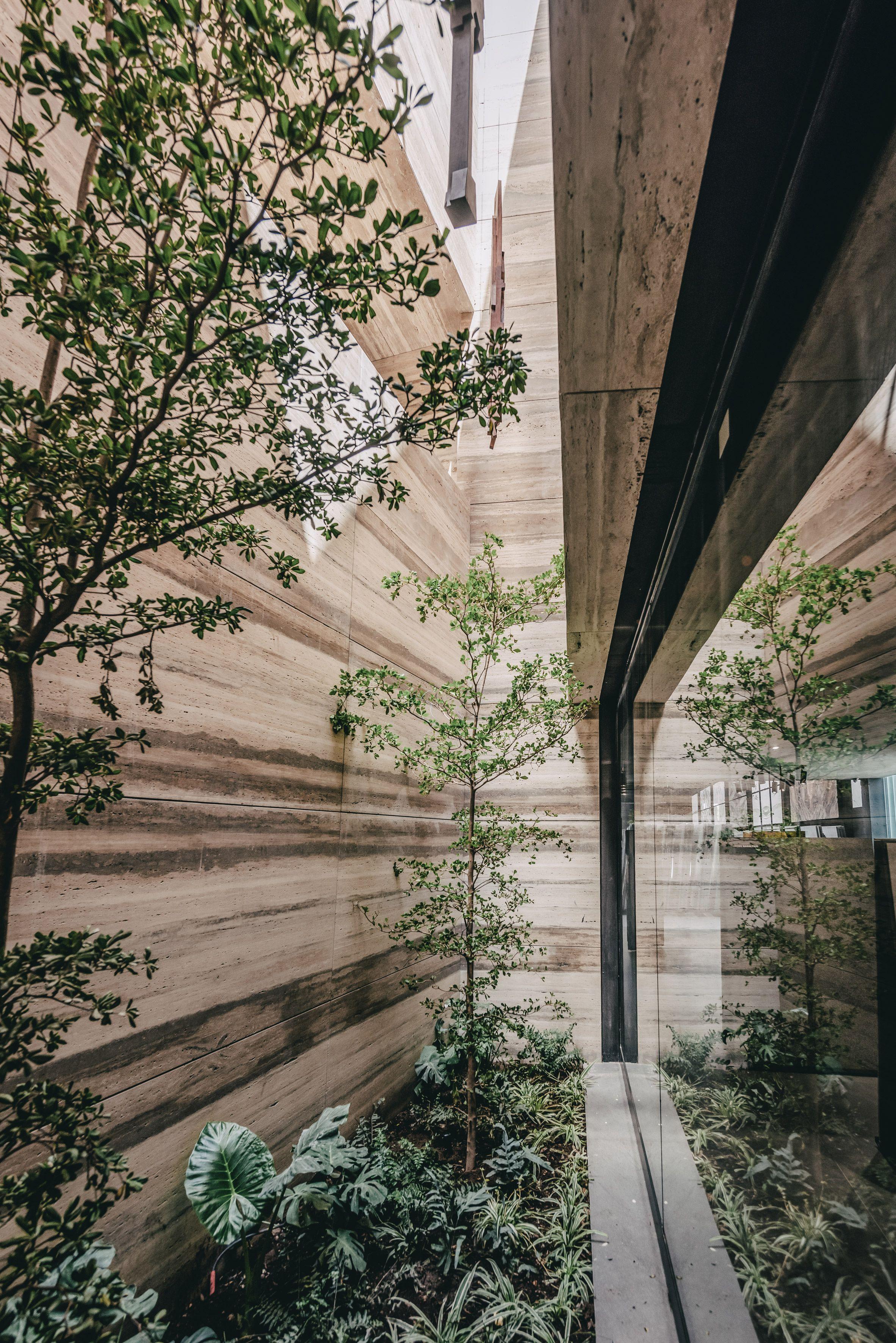 Grupo Arca Showroom Set In A Landscape Of Quarried Stone Norwegian Architecture Landscape Rural Architecture