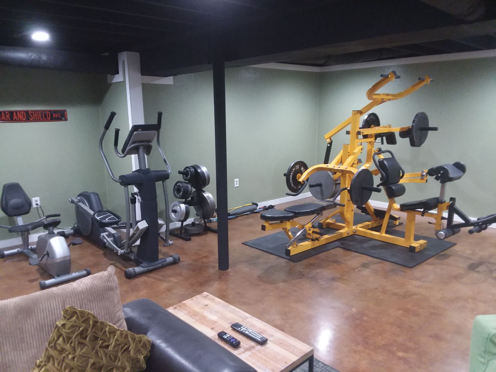 Stained concrete floors, flat black ceiling, Home Gym