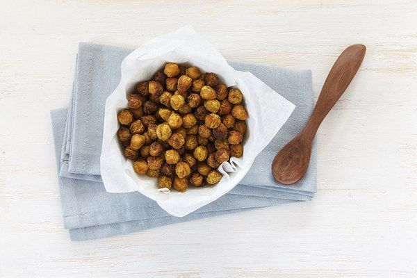"""Roasted chickpeas are a great go-to high-protein snack. Rinse a can of chickpeas, spread on a baking sheet and toss with olive oil and a few spices of your choice (I typically use paprika, salt, pepper, and some chili powder). Roast at 400 degrees F for about 20 minutes (shaking the pan occasionally) until chickpeas are slightly brown.  One cup of chickpeas provides 12 grams of protein AND about 12 grams of fiber which is over 30 percent of the daily fiber needs for women."" —Jen Flachbart…"