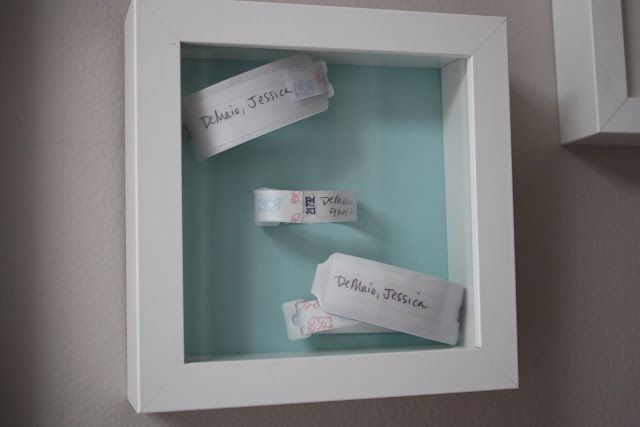 Framed hospital bracelets from mommy, daddy and baby via A Simple Kind of Life