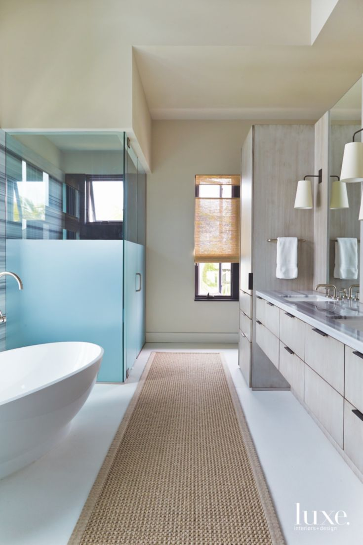 Master Bathroom with Frosted Glass Large Soaking Tub and Long Runner ...