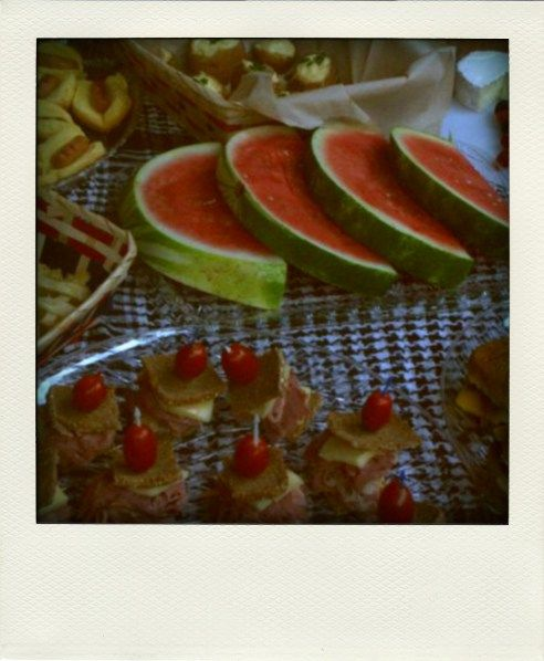 Mini Reuben's with sliders, watermelon, mini hot dogs, apple pie tartlets, Brie, berries and champagne for Fourth of July picnic.