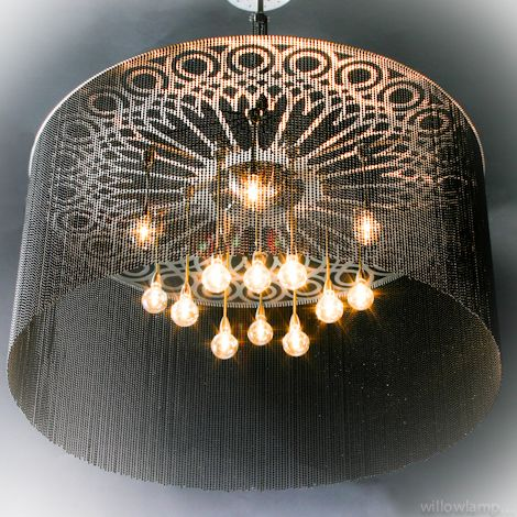 Ngoma drum chandeliers a cylindrical drum shaped chandelier with a support frame inspired by venetian wrought iron design illuminated by suspended circular