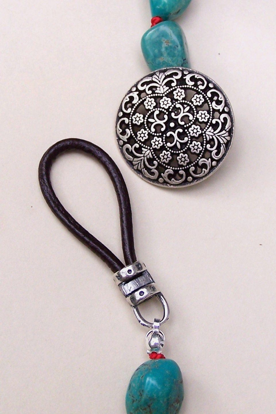 button clasp - use elastic cord! much easier to handle- good I, use ...
