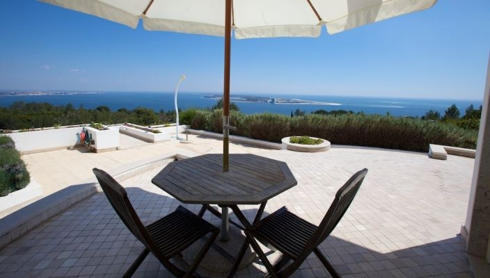 Windmill and rooms, located at Serra da Arrábida, Hotel Quinta dos Moinhos de S. Filipe, view to River Sado, Setúbal, Portugal