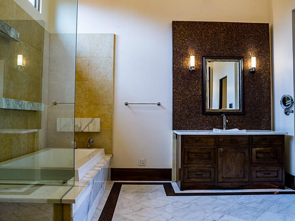 I like how the vanity is framed and the floating shelves over the bath.
