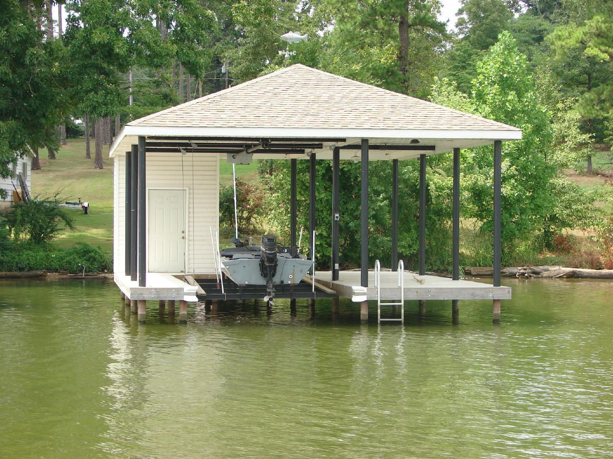 Storage shed over water solves variance problem future for Boat garage on water
