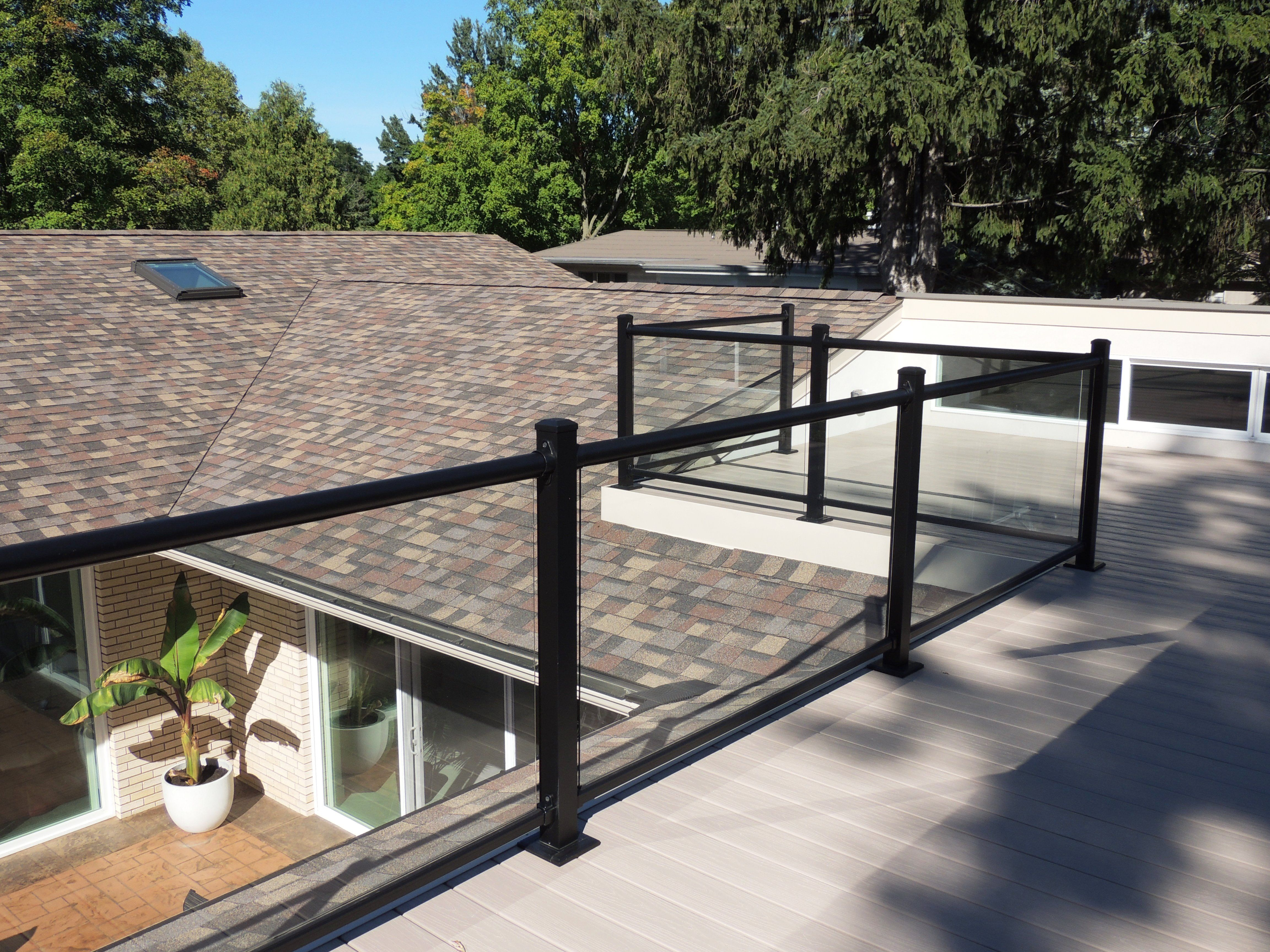 Glass railings for decks - Ornamental Glass Railing On Top Of Roof Top Deck