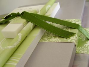 Green and silver wrapped books and stationery