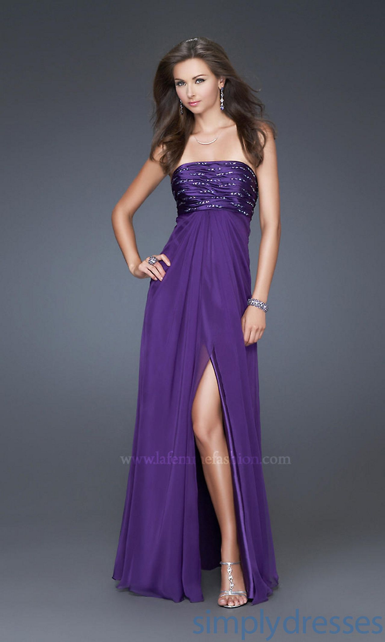 Pretty purple dress! And might cover my not so flat mommy tummy ...