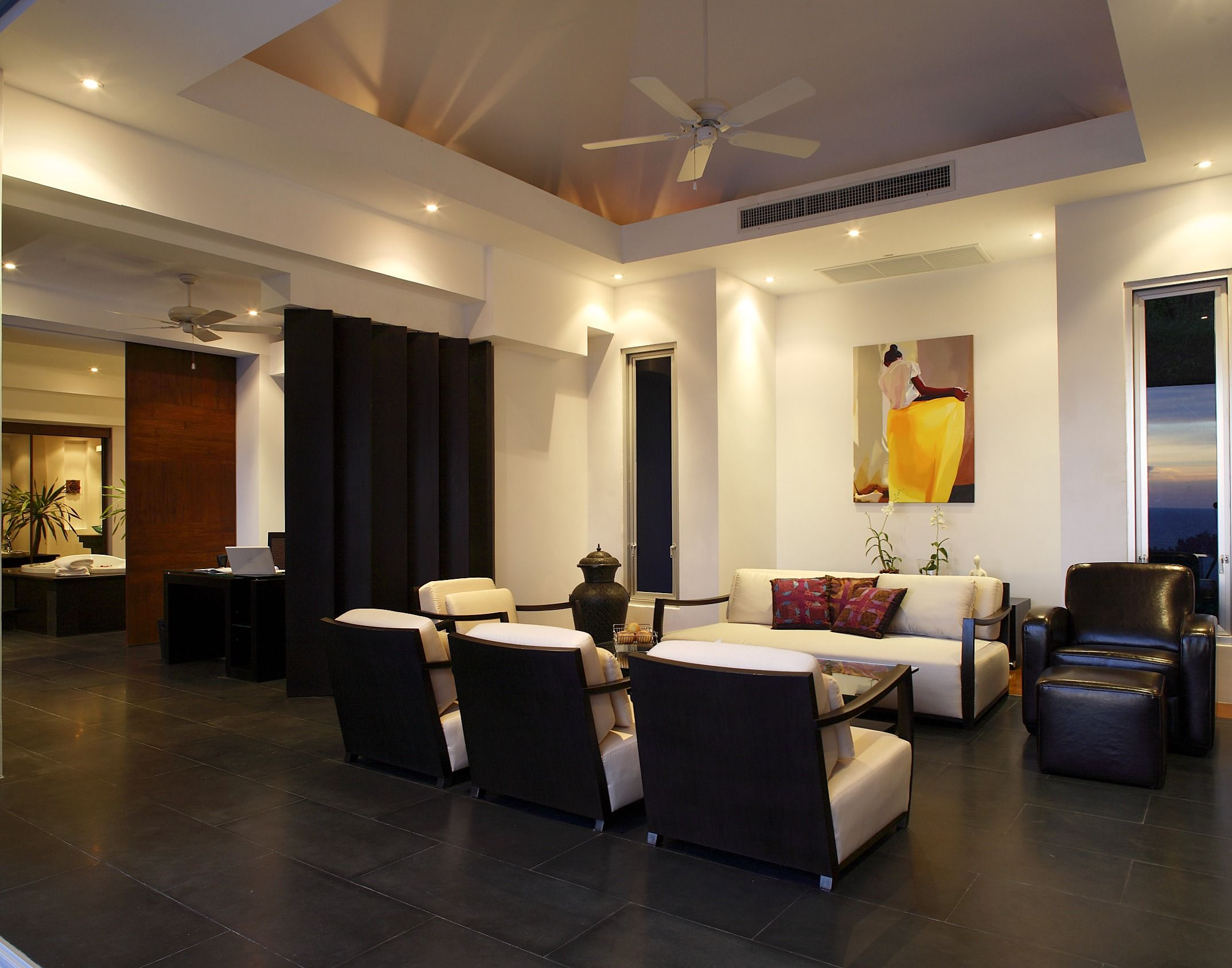 A bright and modern open concept living room with black