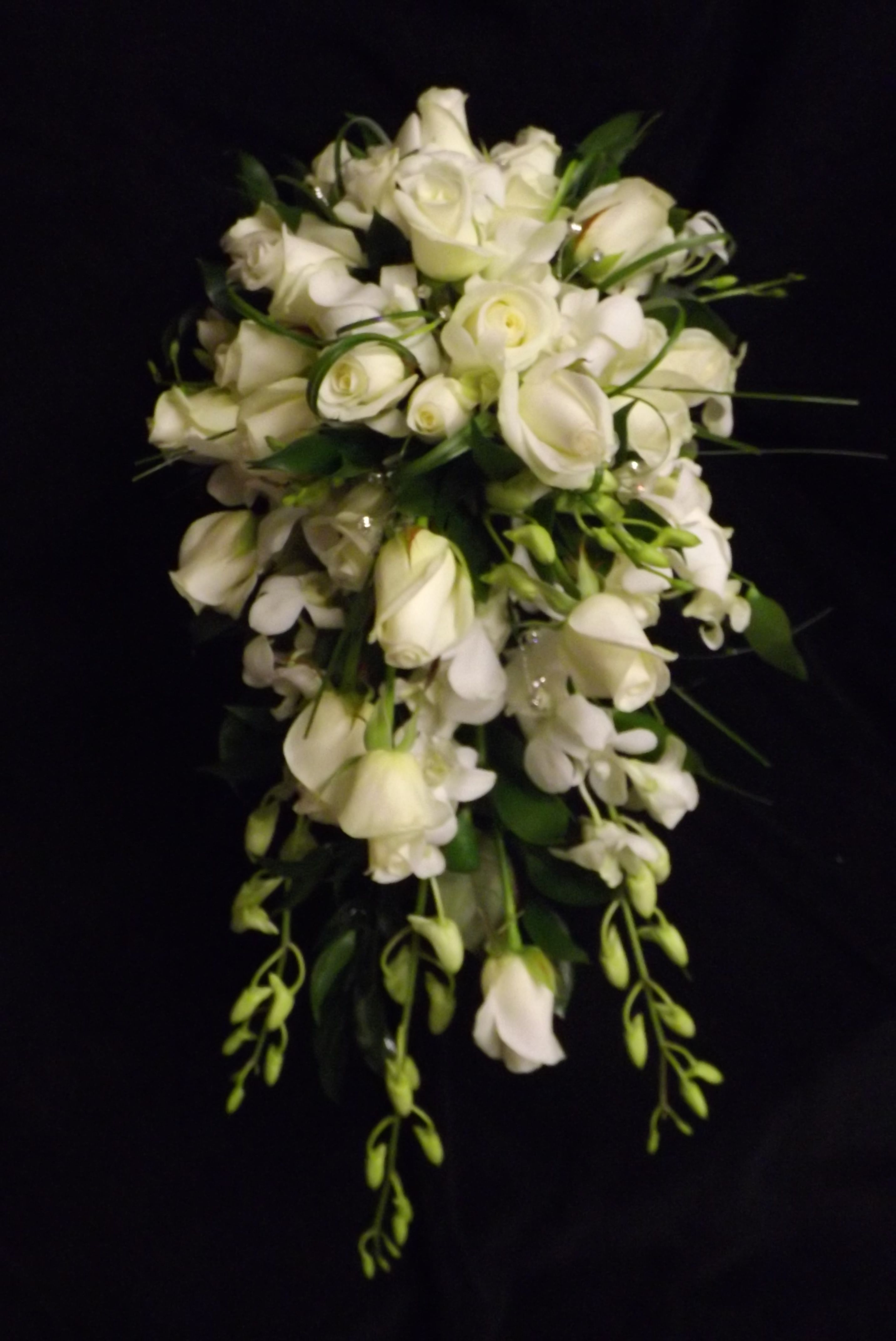 Singapore Orchid And Roses In A Cascade Shower Bouquet Www Weddingflowersbylaura Com Floral Wedding Bouquet Images Spray Roses