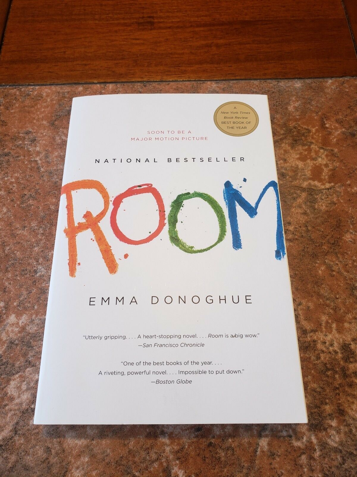 Book titled room by emma donoghue with images room