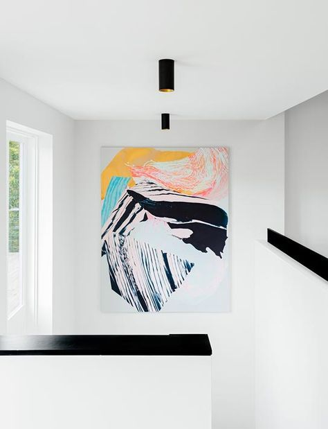 Park View House | Arent & Pyke | large oversized colorful abstract painting artwork in stairwell with high ceiling