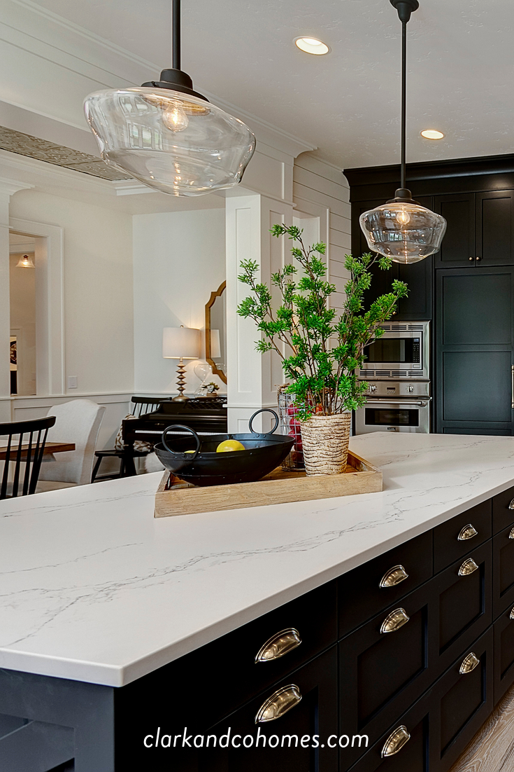 Black Custom Cabinets Contrast With The White Quartz Countertops