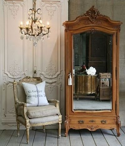 French Antique Armoire, Crystal And Gold Chandelier, Classic Chair Backed  By A Pair Of