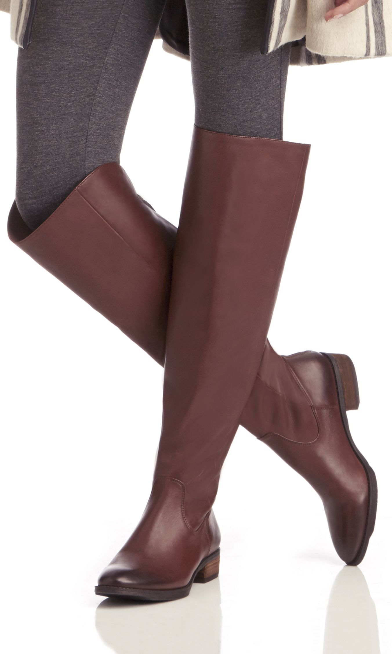 Luxurious leather over-the-knee riding boots with an almond toe, back zipper and stacked heel. An equestrian-inspired classic.