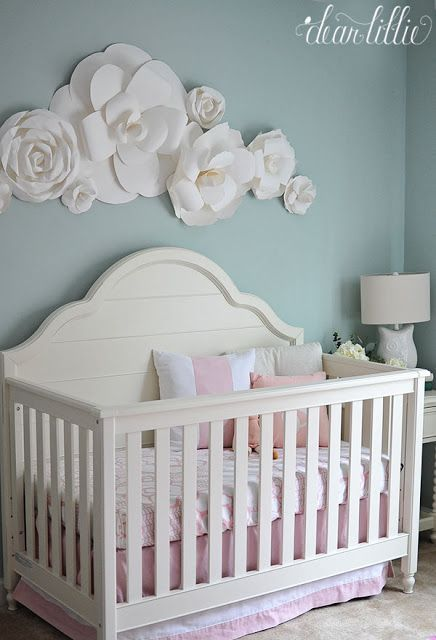 Large paper flower accents over crib for accent wall