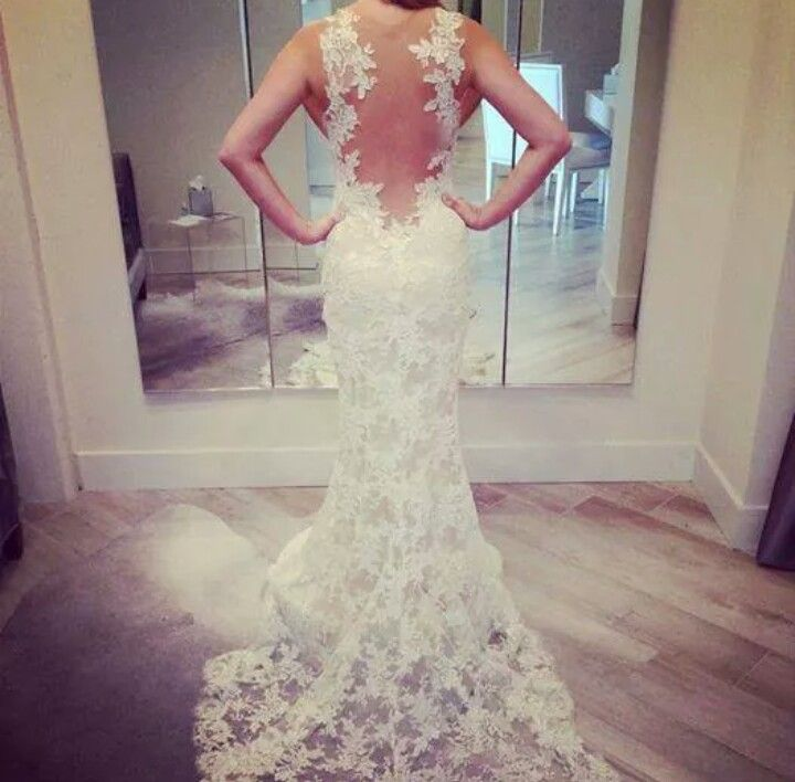 Another gorgeous low feature back on this stunning wedding dress with so much lace detail!