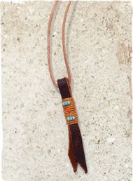 The rustic leather cord necklace showcases a simple leather strand pendant accented with blue glass beads.