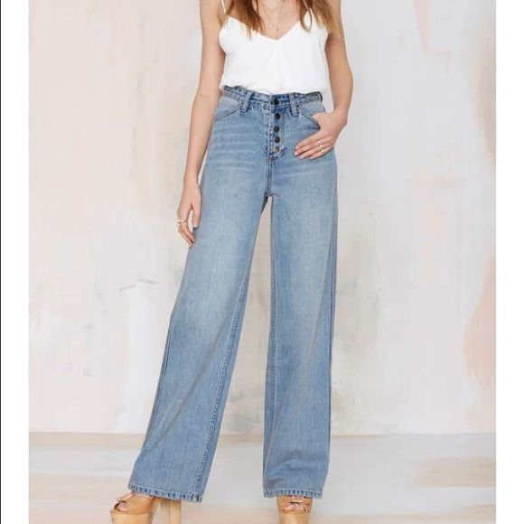 "#539 nasty gal We're not about fitting in—until it comes to denim. Our vintage-inspired Nasty Gal Denim Collection is all about custom washes, perfect fits, and making your butt look good. The Wide Strider features high waisted silhouette, wide legs, four-pocket design, and button fly. Brushed metallic hardware, faded wash. Give your skinnies a break, and team these babies up with a vintage crop halter *Cotton  *28""/71cm waist  *11""28cm rise  *33""/84cm inseam  *43""/109cm length  *Runs true…"