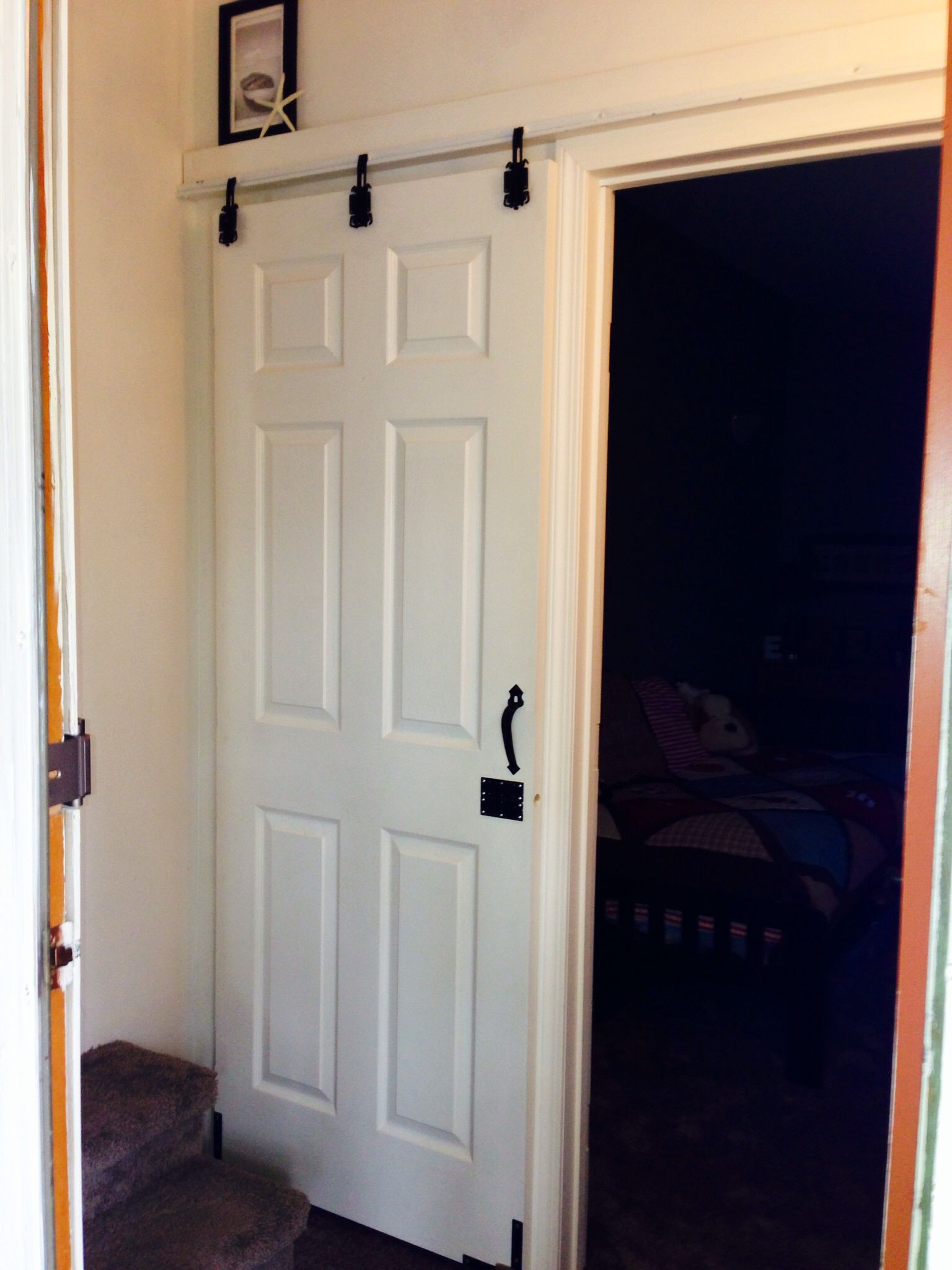 Sliding Hanging Door diy sliding door..cheap-o style that i did using $6 worth of