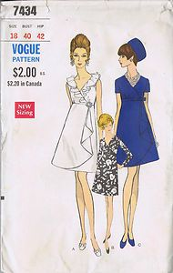 "MISSES SHEATH DRESS PATTERN NUMBER 7434 Vogue Pattern Company -- Copyright 1960s SIZE 18 BUST 40 WAIST 31 HIP 42"" Vogue Pattern Pattern Number 7434 Copyright: 1960s MISSES ONE PIECE EMPIRE STYLE DRESS PATTERN High waisted A-line Dress pattern with or without front draped Over-skirt, has wrapped bodice with V-neckline with or without ruffle. Seven-eights or short sleeves, or sleeveless. Self or purchased belt."