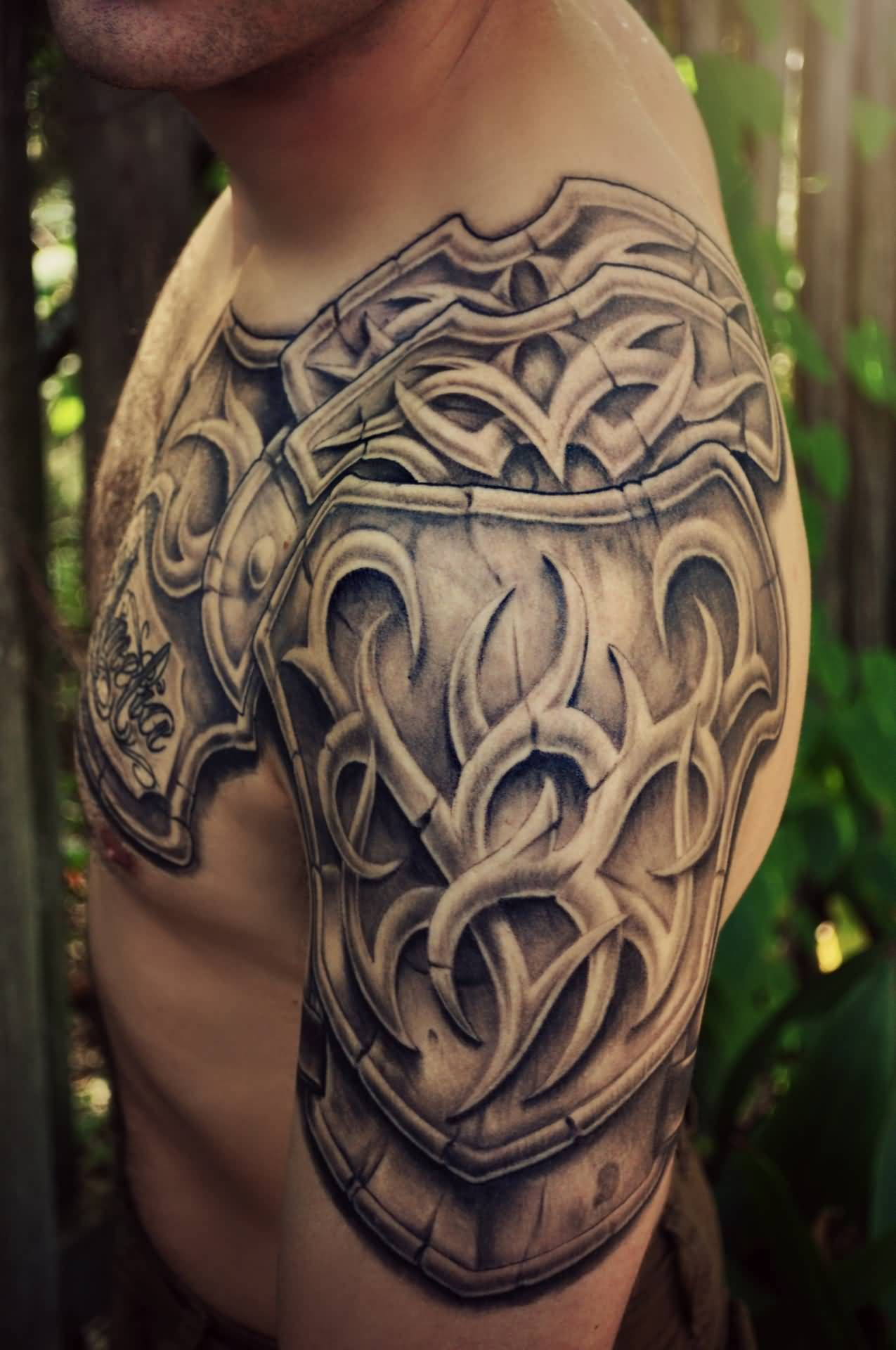 Grey Ink Shoulder Armor Tattoo For Men With Images Shoulder Armor Tattoo Armor Tattoo Tattoos