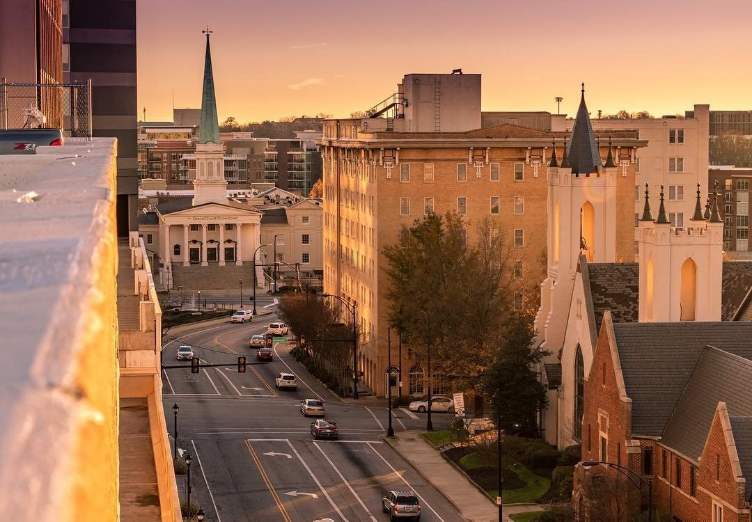First light pours over downtown greenville sc photo