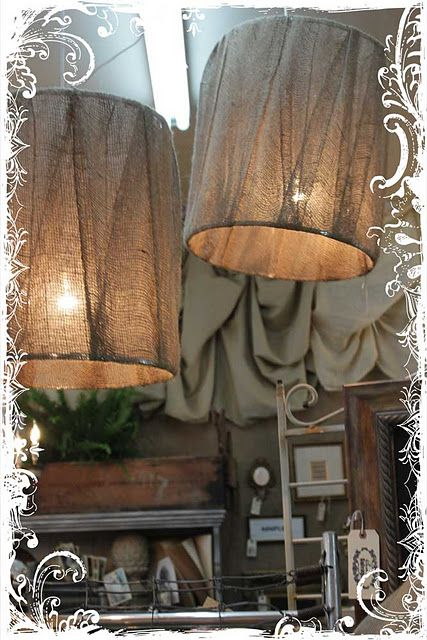 burlap lamp shades, would be cute with some kind of stencil on it ...