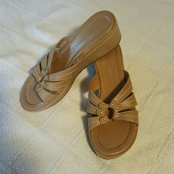 Apostrophe Sandals Tan sandals with off white topstitching. Very little wear time. Apostrophe Shoes Sandals