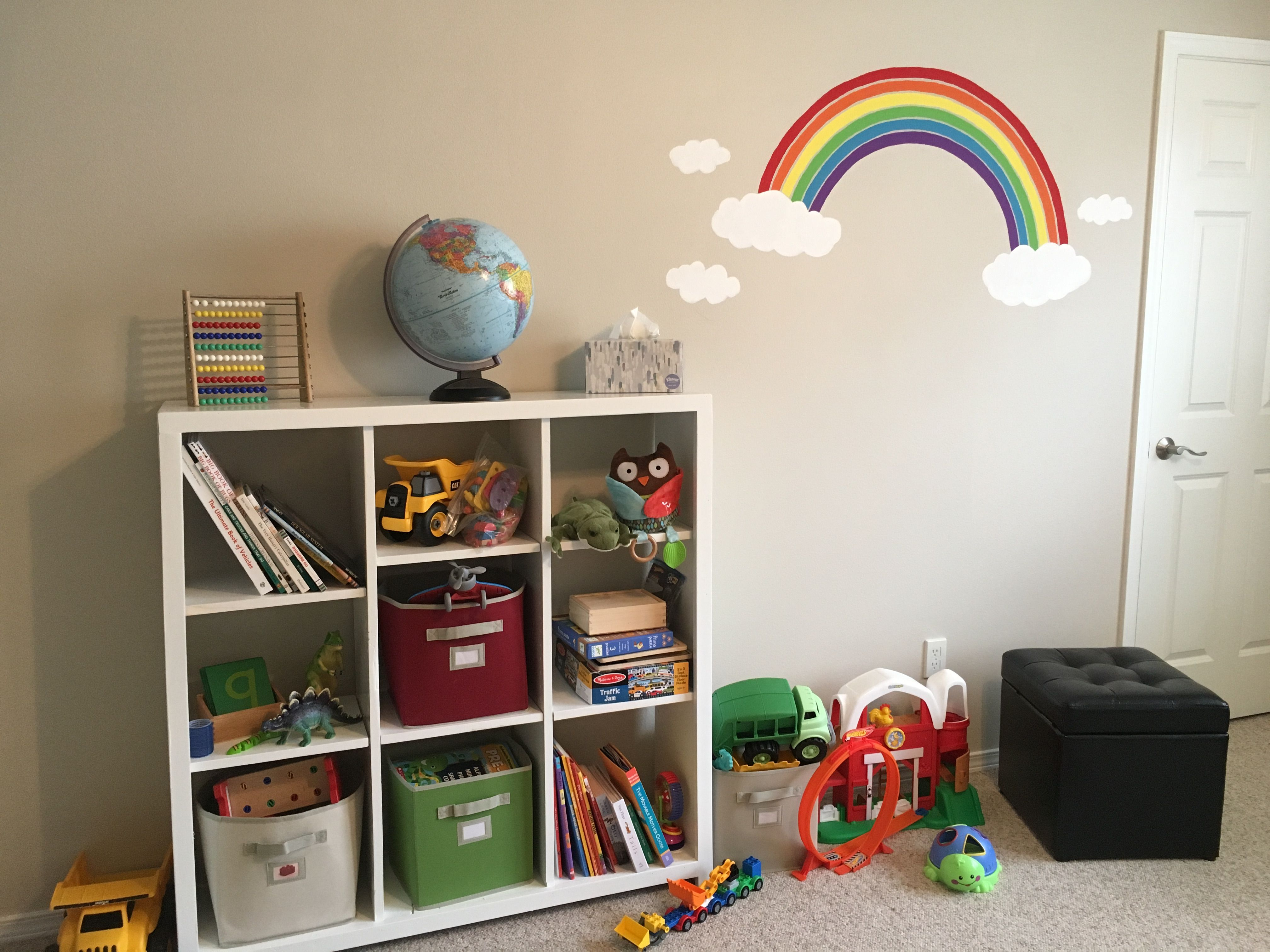 Playroom with diy cubbies and hand painted rainbow with