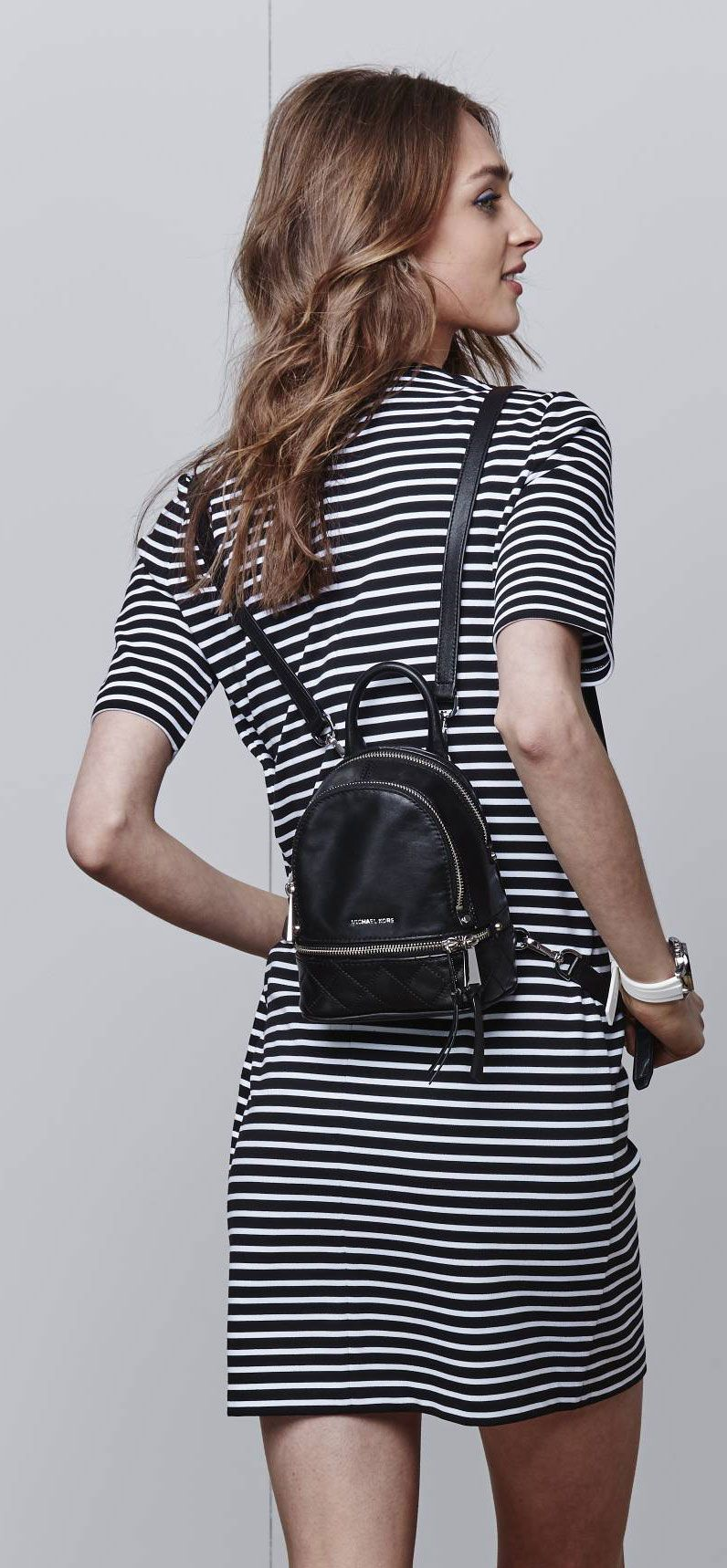 8ad6e8c9f8f1 The ultimate summer essential, this mini MICHAEL Michael Kors backpack  makes traveling a breeze. The perfect size for just the essentials, this  knapsack ...