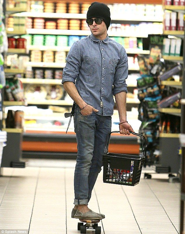 Zac Efron whizzes around the grocery store on his skateboard