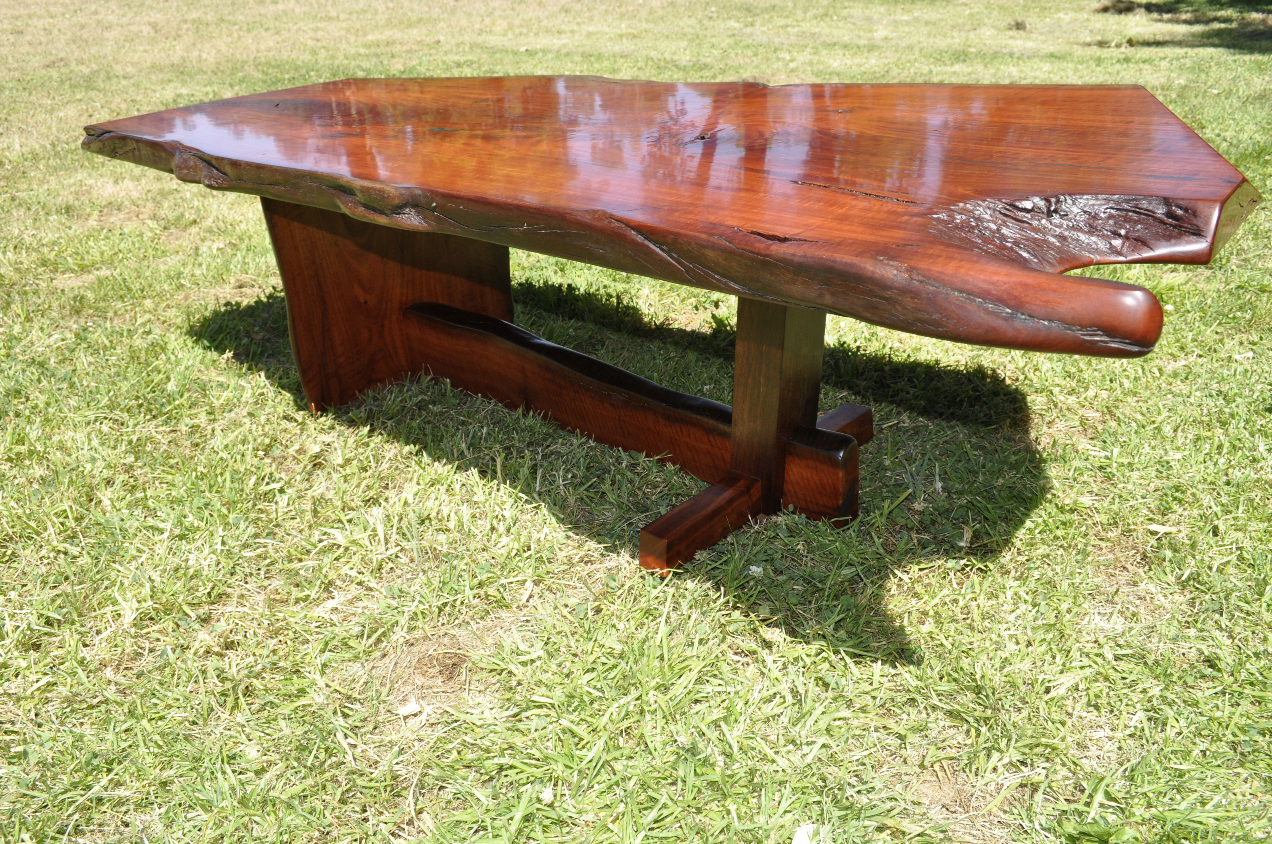 Termite Table A single Redgum slab with natural live edges An