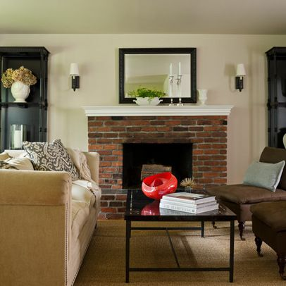 your red brick fireplace with black accents, neutral sisal ...