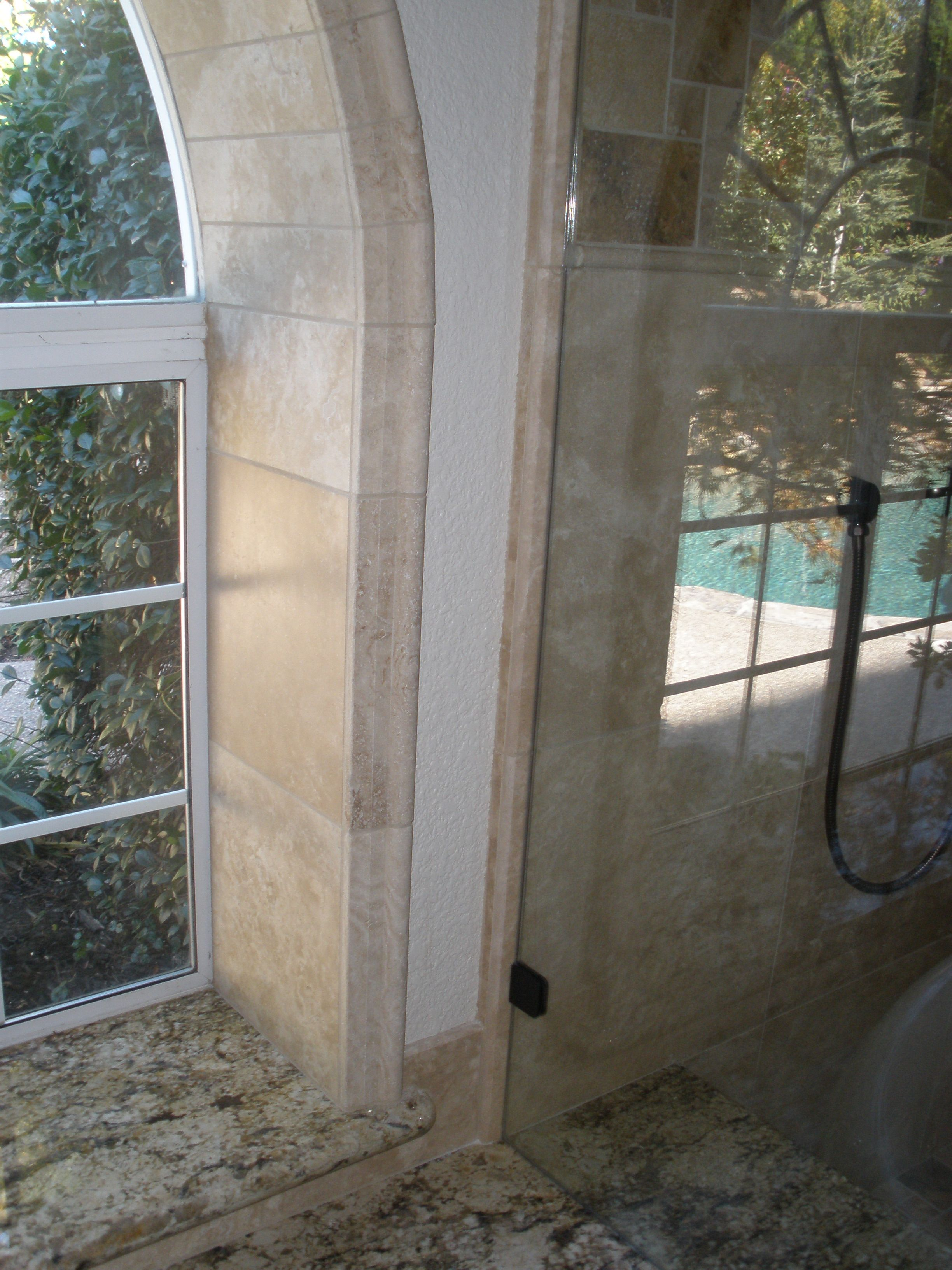 The Edge Of This Window Is Trimmed With A Travertine Chair Rail. Each Piece  Is