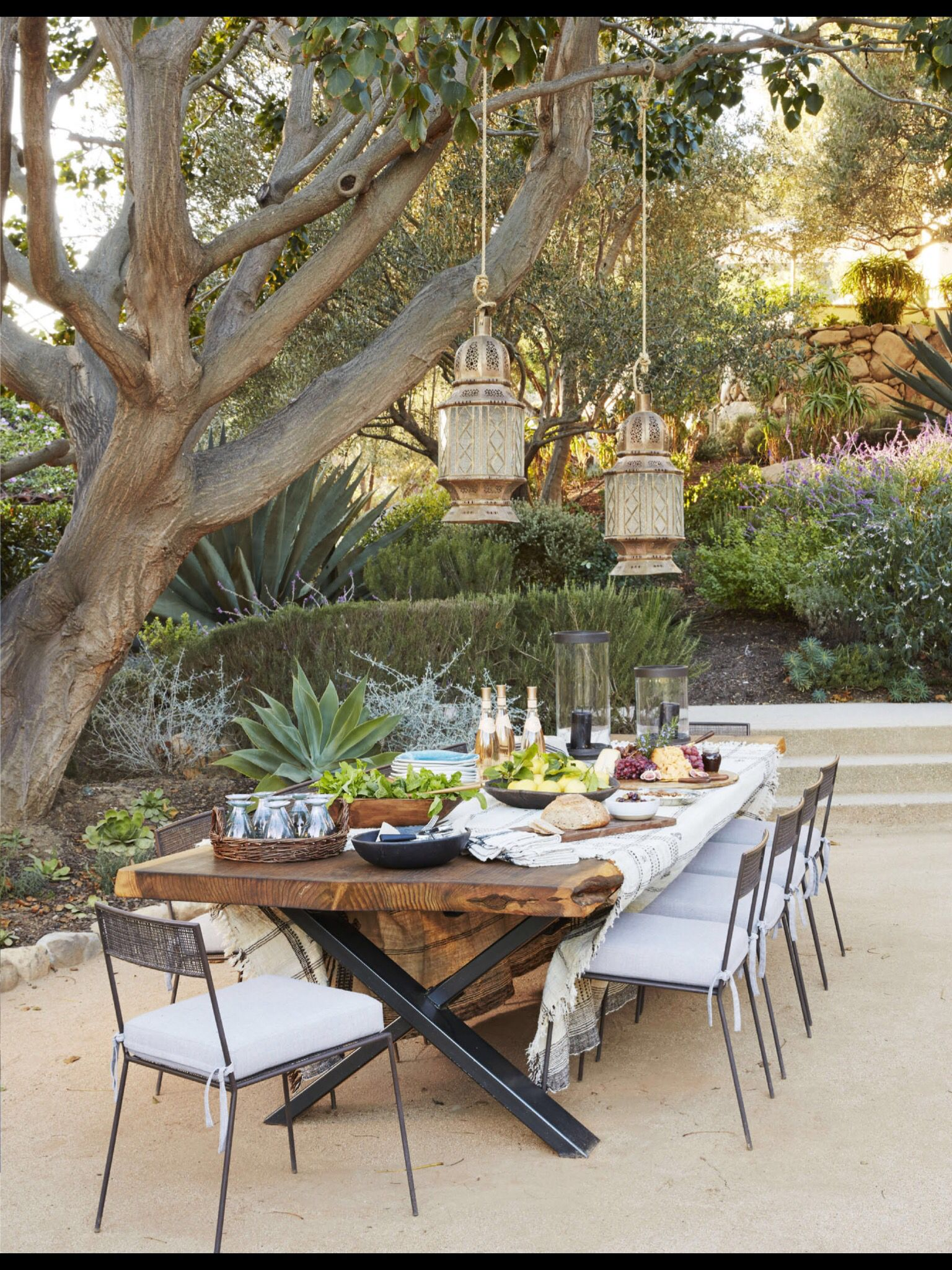 Backyard Dining An Exquisite Dining Area Underneath The Beautiful Trees With The Gorgeous Lamps Hanging Over Outdoor Dining Room Outdoor Dinner Backyard Patio